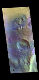 This image from NASA's Mars Odyssey shows an unnamed crater in Arabia Terra. Dark blue tones in false color indicate basaltic sands.