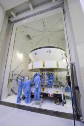 Engineers and technicians working on NASA's Mars 2020 mission prepare spacecraft components for acoustic testing in the Environmental Test Facility at NASA's Jet Propulsion Laboratory in Pasadena, California.