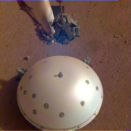 This image shows NASA's InSight lander's domed Wind and Thermal Shield, which covers its seismometer. The image was taken on the 110th Martian day, or sol, of the mission.