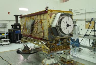 OCO-3 sits on the large vibration table (known as the 'shaker') in the Environmental Test Lab at the Jet Propulsion Laboratory.
