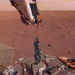 The robotic arm on NASA's InSight lander deployed its Heat Flow and Physical Properties Package (HP3) instrument on the Martian surface on Feb. 12, 2019.