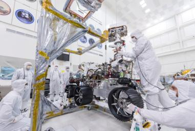 In this image, taken on June 13, 2019, engineers at JPL install the starboard legs and wheels on NASA's Mars 2020 rover.
