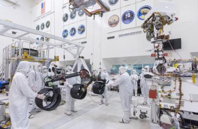 In this image, taken on June 13, 2019, engineers prepare the starboard legs and wheels for integration onto NASA's Mars 2020 rover.