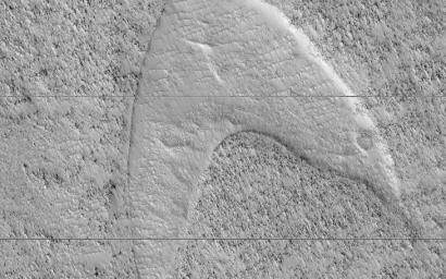 This image, acquired on April 22, 2019 by NASA's Mars Reconnaissance Orbiter, shows curious chevron shapes in southeast Hellas Planitia which are the result of a complex story of dunes, lava, and wind.