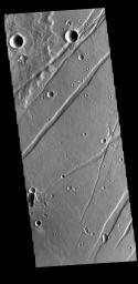 This image from NASA's Mars Odyssey shows linear depressions, graben, called Labeatis Fossae.