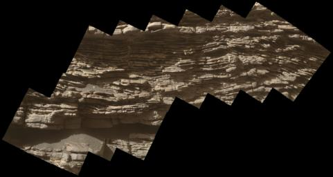 This mosaic of images shows layers of ancient sediment on a boulder-sized rock called 'Strathdon,' as seen by the Mars Hand Lens Imager (MAHLI) camera on NASA's Curiosity rover.