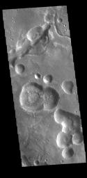 This image from NASA's Mars Odyssey shows pits and channels located along the margin between Arabia Terra and Acidalia Planitia.