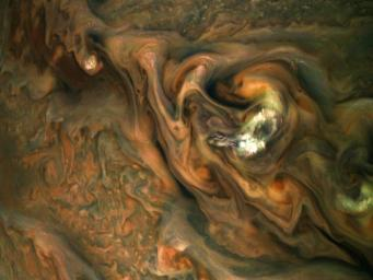 This view from NASA's Juno spacecraft captures colorful, intricate patterns in a jet stream region of Jupiter's northern hemisphere known as Jet N3.