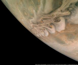 NASA's Juno spacecraft captured this impressive image revealing a band of swirling clouds in Jupiter's northern latitudes during Juno's close flyby on Nov. 3, 2019.