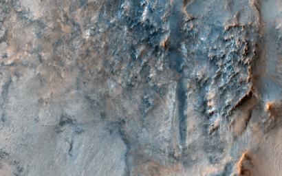 This image, acquired on May 20, 2019 by NASA's Mars Reconnaissance Orbiter, shows the Nili Fossae region, to the west of the great Isidis basin, with layered bedrock and many impact craters.