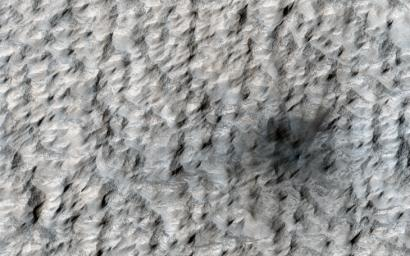 This image, acquired on May 31, 2019 by NASA's Mars Reconnaissance Orbiter, shows a small crater, just seven meters across, was created on Mars sometime between April 2018 and January 2019.