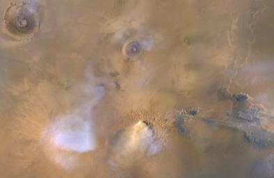 This image, taken on Nov. 30, 2010, by NASA's Mars Reconnaissance Orbiter, shows a Mars dust tower, a concentrated cloud of dust that can be lofted dozens of miles above the surface.