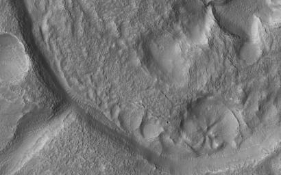 This image acquired on September 30, 2019 by NASA's Mars Reconnaissance Orbiter, shows a small crater, probably once filled with an ice-covered lake that overflowed, forming the exit channel.