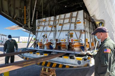Some of the nearly 5,000 pounds (2,270 kilograms) of Perseverance mission flight hardware, test gear and equipment delivered to Kennedy Space Center on May 11, 2020, is unloaded from a NASA Wallops C-130.