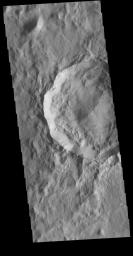 This image from NASA's Mars Odyssey shows an unnamed crater located on the boundary between Terra Cimmeria and Nepenthes Planum.