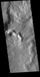 This image from NASA's Mars Odyssey shows an unnamed channel in Terra Sabaea.