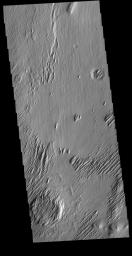 This image from NASA's Mars Odyssey shows Lucus Planum. The surface in this image has been eroded by the wind to form features called yardangs.