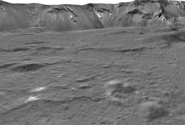 This view across the southeastern floor of the large Occator Crater on the dwarf planet Ceres is based on images obtained during NASA's Dawn spacecraft second extended mission in 2018.
