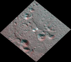 This Dawn stereo anaglyph of Occator Crater on Ceres shows bright carbonate deposits draped on ridged impact melt deposits in the eastern section of the 57-mile (92-kilometer) crater.
