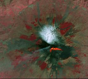NASA's Terra spacecraft shows Mt. Etna, Italy, sending rivers of lava down the southeast flank of the volcano. The ASTER visible image shows the extent of the active lava flows (derived from the thermal infrared data).