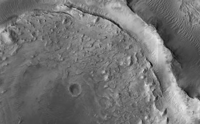 This image acquired on January 3, 2021 by NASA's Mars Reconnaissance Orbiter, shows evidence of a complex cycle of cratering and erosion.