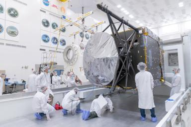 This image, shot March 28, 2021 shows engineers and technicians preparing to move the Solar Electric Propulsion (SEP) Chassis from its shipping container to a dolly in High Bay 1 of JPL's Spacecraft Assembly Facility.