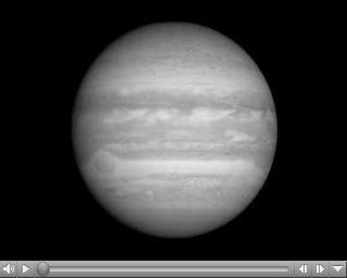 Click here for movie of PIA09235 On Approach: Jupiter and Io