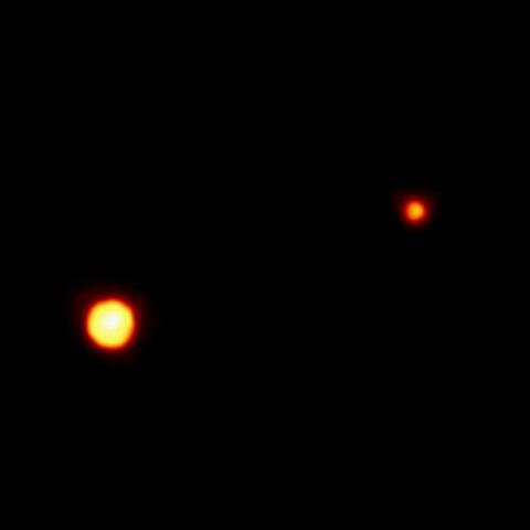 This is the clearest view yet of the distant planet Pluto and its moon, Charon, as revealed by NASA's Hubble Space Telescope. The image was taken by the European Space Agency's Faint Object Camera on February 21, 1994.