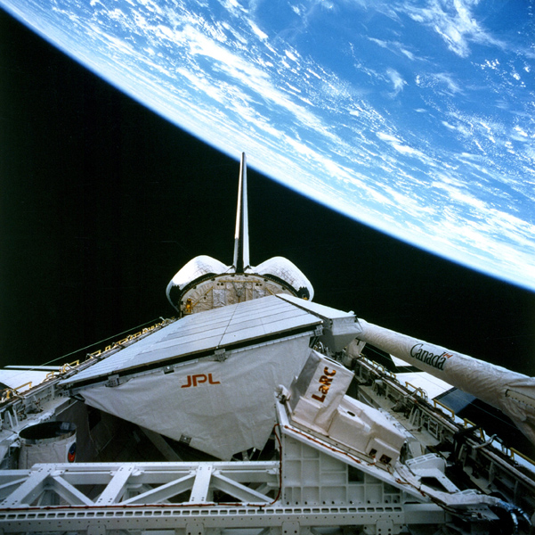 NASA's SIR-C/X-SAR is shown here in the payload bay of the orbiting space shuttle Endeavour (STS-59), with an area of the Pacific Ocean northeast of Hawaii in the background.