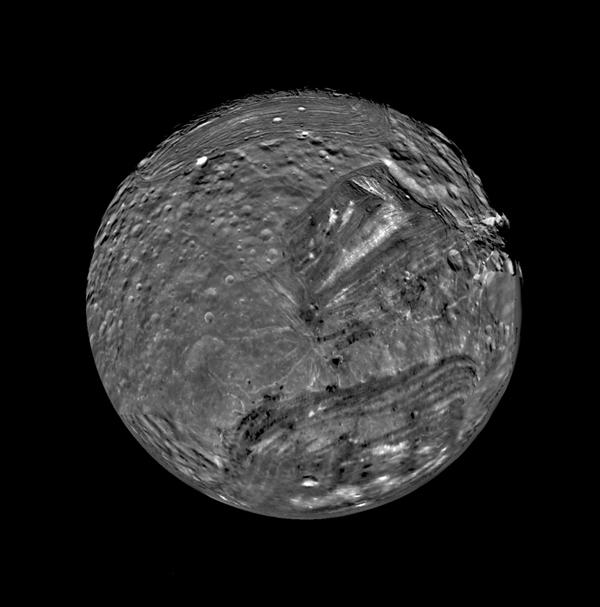 Uranus' moon Miranda is shown in a computer-assembled mosaic of images obtained Jan. 24, 1986, by NASA's Voyager 2 spacecraft. Miranda is the innermost and smallest of the five major Uranian satellites,