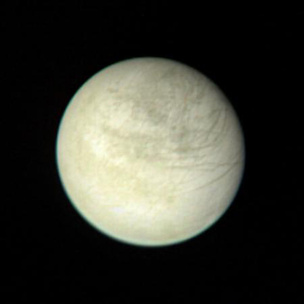 This view of Europa captured by NASA's Voyager 1 was taken from a range of 2,869,252 kilometers (1.6 million miles) on March 2 at 2:00 PM. The color composite is made from three black and white images taken through the orange, green and violet filters.