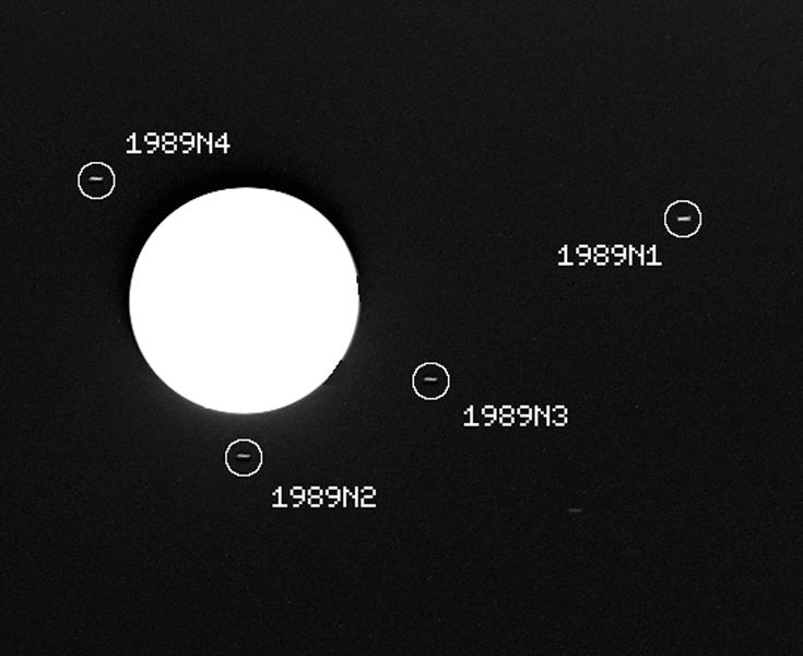 This image captured by the NASA's Voyager 2 spacecraft on July 30, 1989, was used to confirm the discovery of three new satellites orbiting Neptune.
