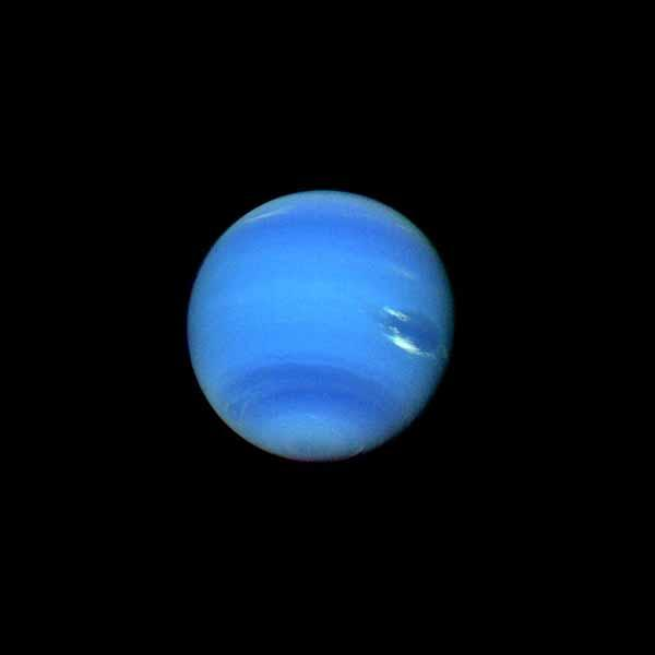 This contrast enhanced color picture of Neptune was acquired by NASA's Voyager 2 on Aug. 14, 1989. As Voyager 2 approached Neptune, rapidly increasing image resolution is revealed striking new details. Bright, wispy clouds are seen overlying the Great Dar