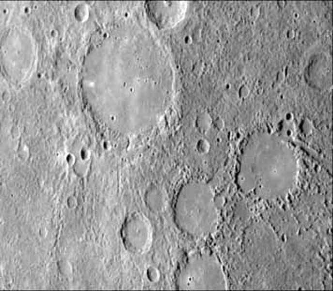 As NASA's Mariner 10 approached Mercury at nearly seven miles per second on March 29, 1974, its TV camera took this picture from an altitude of 35,000 kilometers (21,700 miles) The picture shows a heavily-cratered surface with many low hills