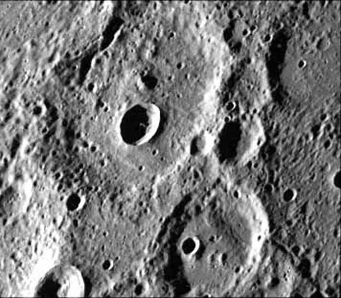 A fresh new crater in the center of an older crater basin is shown in this picture of the surface of Mercury taken March 29, 1974 by NASA's Mariner 10.