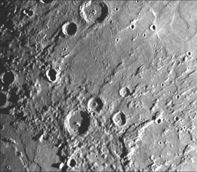 This image, from NASA's Mariner 10 spacecraft which launched in 1974, is of the northeastern quadrant of the Caloris basin showing the smooth hills and domes between the inner and outer scarps and the well-developed radial system east of the outer scarp.