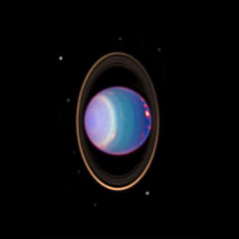 A recent NASA Hubble Space Telescope view reveals Uranus surrounded by its four major rings and by 10 of its 17 known satellites.