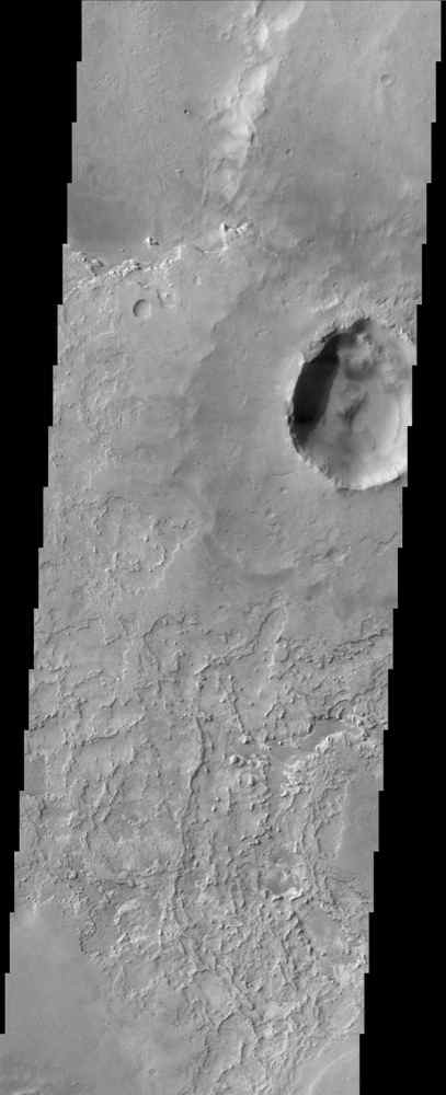 This image from NASA's Mars Odyssey is located near the equator and the prime meridian of Mars in a region called Terra Meridiani. This is a unique area of Mars that displays layers of material that appear to be in the process of being stripped away.