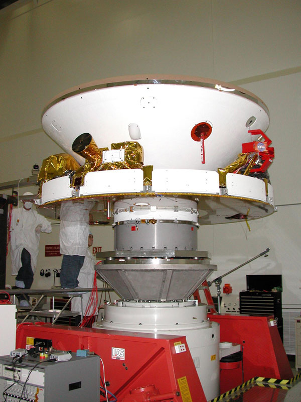 One of two Mars Exploration Rovers sits inside its cruise stage waiting to undergo environmental testing at NASA's Jet Propulsion Laboratory.