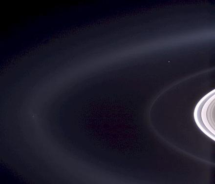 Cassini casts powerful eyes on our home planet, and captures Earth, a pale blue orb -- and a faint suggestion of our moon -- among the glories of the Saturn system.