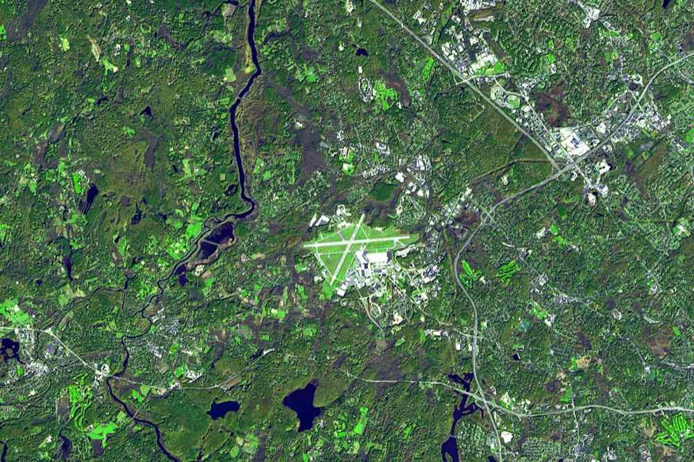 Lexington and Concord, Massachusetts are now dwarfed by Hanscom Air Force Base between them. NASA's Terra satellite acquired this image in October 2006,