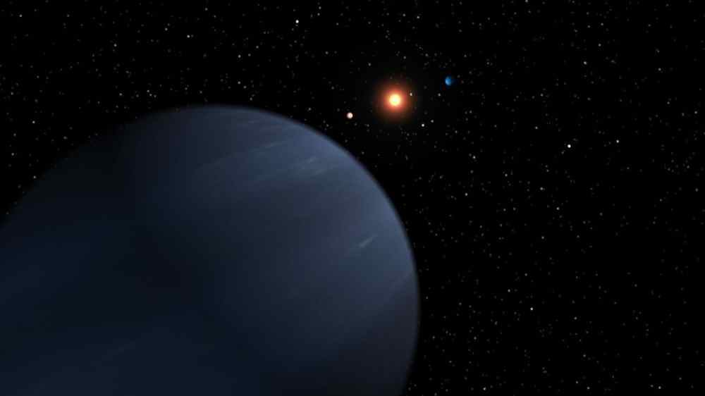 This artist's concept shows four of the five planets that orbit 55 Cancri, a star much like our own. The most recently discovered planet, and the fourth out from the star, looms large in the foreground.