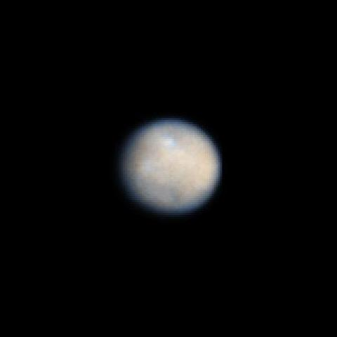 This is a NASA Hubble Space Telescope color image of dwarf planet Ceres, the largest object in the asteroid belt. The contrast has been enhanced to reveal surface details.
