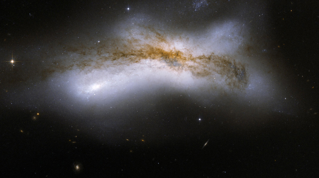 NGC 520 is the product of a collision between two disk galaxies that started 300 million years ago. This image is part of a large collection of images of merging galaxies taken by NASA's Hubble Space Telescope.