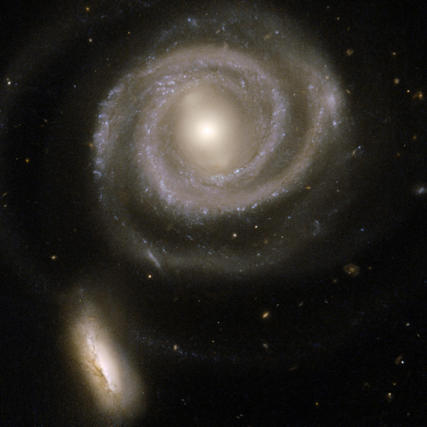 This beautiful pair of interacting galaxies consists of NGC 5754, the large spiral on the right, and NGC 5752, the smaller companion in the bottom left corner of the image. This image is from NASA's Hubble Space Telescope.