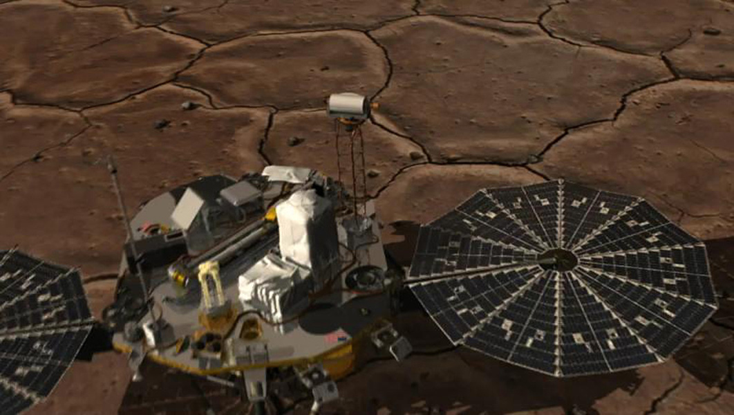 This image shows how NASA's three-legged Phoenix Mars Lander is able to get a better look at its footing and the physical characteristics of the underlying soil on the surface of the Red Planet.