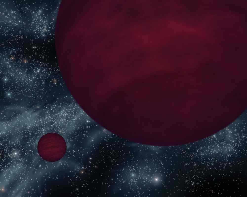 This artist's concept based on data from NASA's Spitzer shows the dimmest star-like bodies currently known -- twin brown dwarfs referred to as 2M 0939. The twins, which are about the same size, are drawn as if they were viewed close to one of the bodies.