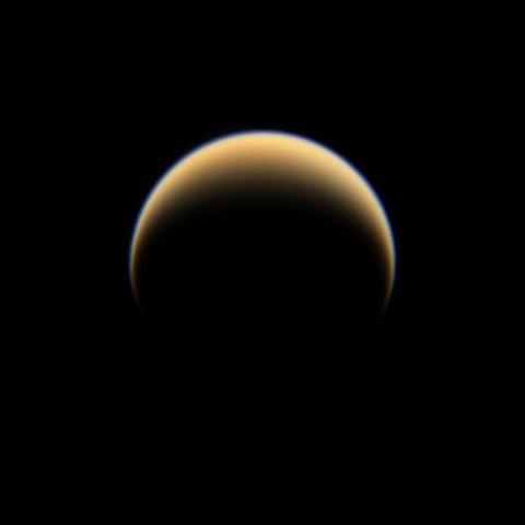 The Cassini spacecraft looks down on the north pole of Titan, showing night and day in the northern hemisphere of Saturn's largest moon.