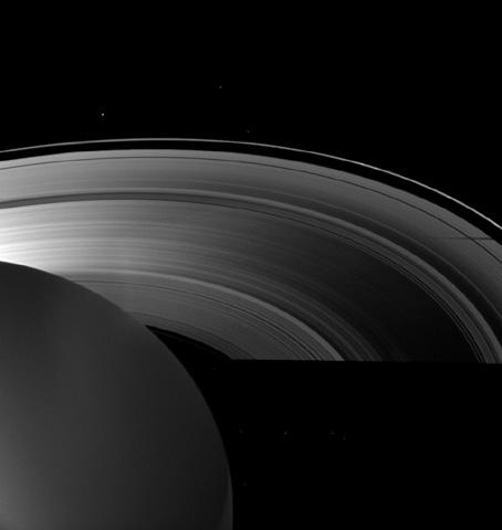 Saturn's moon Tethys casts a shadow on the planet's A ring alongside the larger shadow cast by the planet itself in this image taken as Saturn approached its August 2009 equinox.