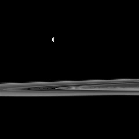 NASA's Cassini spacecraft captures a couple of small moons in this image taken while the spacecraft was nearly in the plane of Saturn's rings.